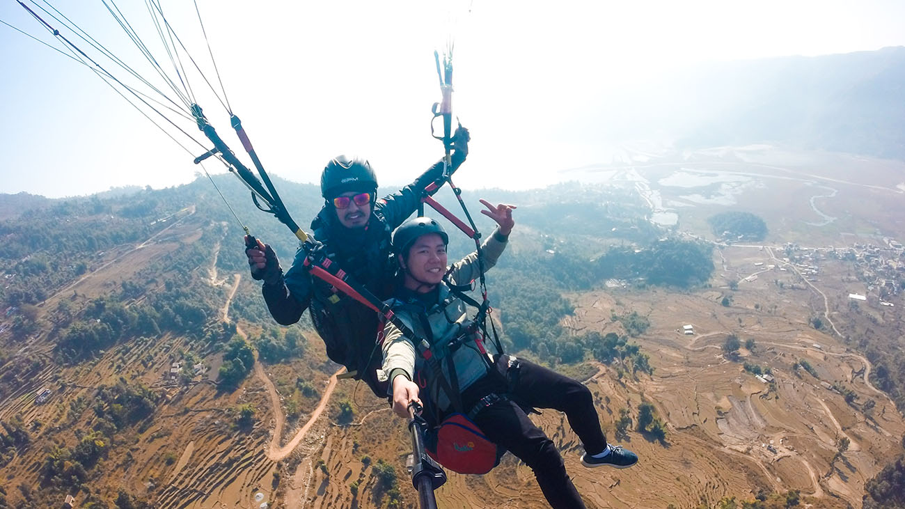 Me with my guide gliding above the fields and rivers of Pokhara